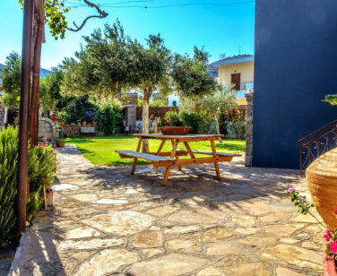 Elounda Apartments & Studios - Corali Studios & Portobello Apartments - Garden Table 2